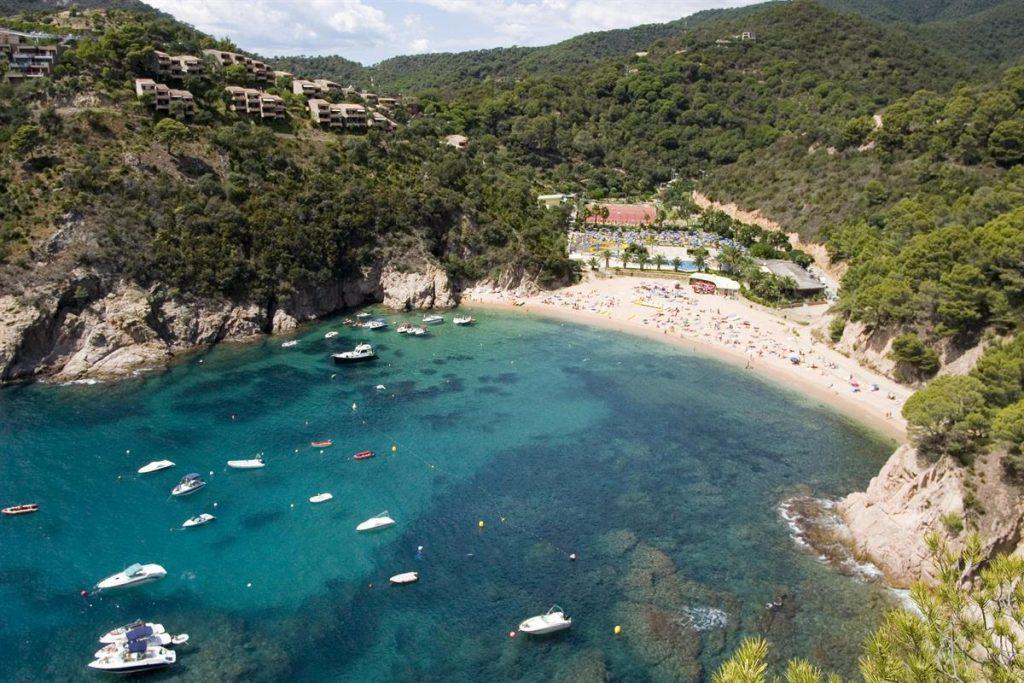 La playa Porto Pí / Martossa / Lloret Garbi se encuentra en el municipio de Tossa de Mar, perteneciente a la provincia de Girona y a la comunidad autónoma de Cataluña